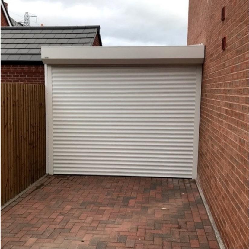 Carport with Roller Garage Door Bever Worcestershire